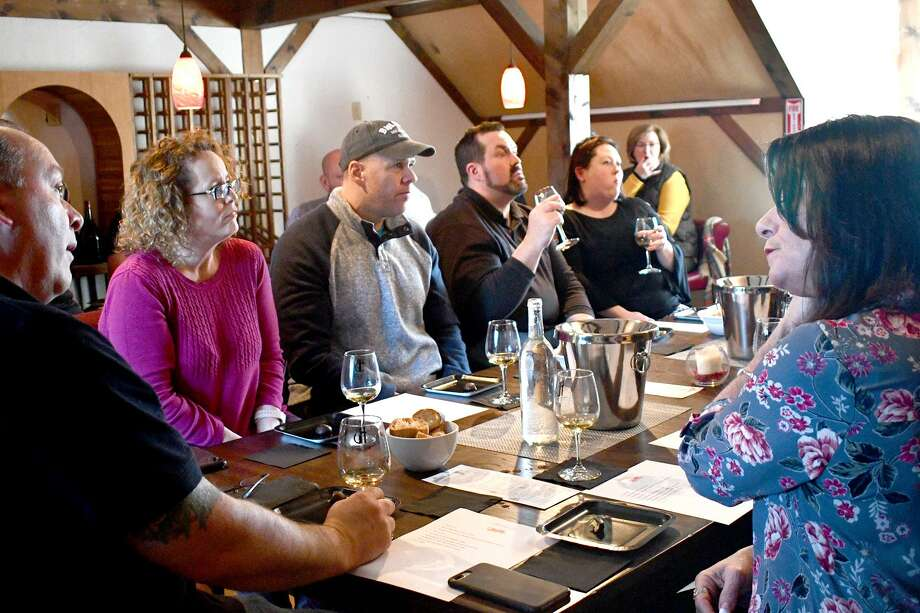 Haight-Brown Vineyard on Chestnut Hill Road, Litchfield, holds numerous classes and tastings on wine, providing residents with the opportunity to visit the vineyard and learn about how it's made and more importantly, how to enjoy it with different foods and desserts. Above, a group of wine class participants take part in a tasting. To learn more about the vineyard and what's coming up, visit http://www.haightvineyards.com or call 860-567-4045. Photo: Lara Green-Kazlauskas / For Hearst Connecticut Media