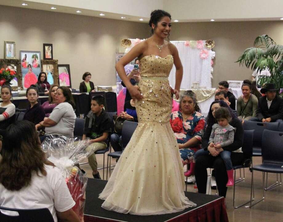 Betty Escamilla walks down the runway wearing a prom dress at the Glamour Expo. Photo: Jacob McAdams / Jacob McAdams