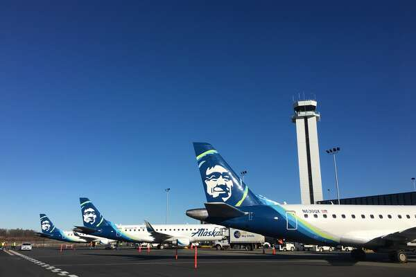 Three Alaska Airlines planes lined up for service to begin out of a new passenger terminal at Paine Field in Everett on Monday, March 4, 2019.