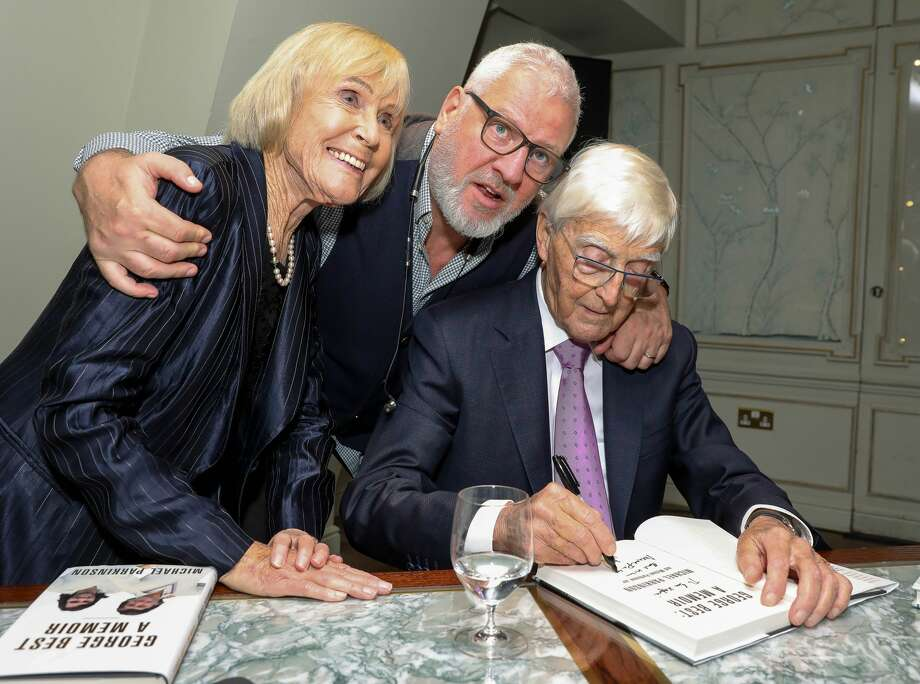 "Ray Kelvin, founder and CEO of Ted Baker, poses with Lady Mary Parkinson and Sir Michael Parkinson at the book launch for ""George Best: A Memoir"" in London, England last November. Kelvin resigned on Monday, months after allegations that he made sexually suggestive comments toward employees and was prone to inappropriate hugging and touching at work. Photo: David M. Benett/Dave Benett/Getty Images"