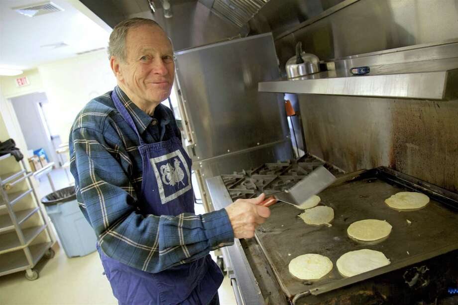 "Dan Wilder of Weston, started the tradition with the 100-year-old starter at the Emmanuel Episcopal Church's ""Shrove Sunday"" pancake breakfast on Sunday, March 3, 2019, in Weston, Conn. Photo: Jarret Liotta / For Hearst Connecticut Media / Westport News Freelance"