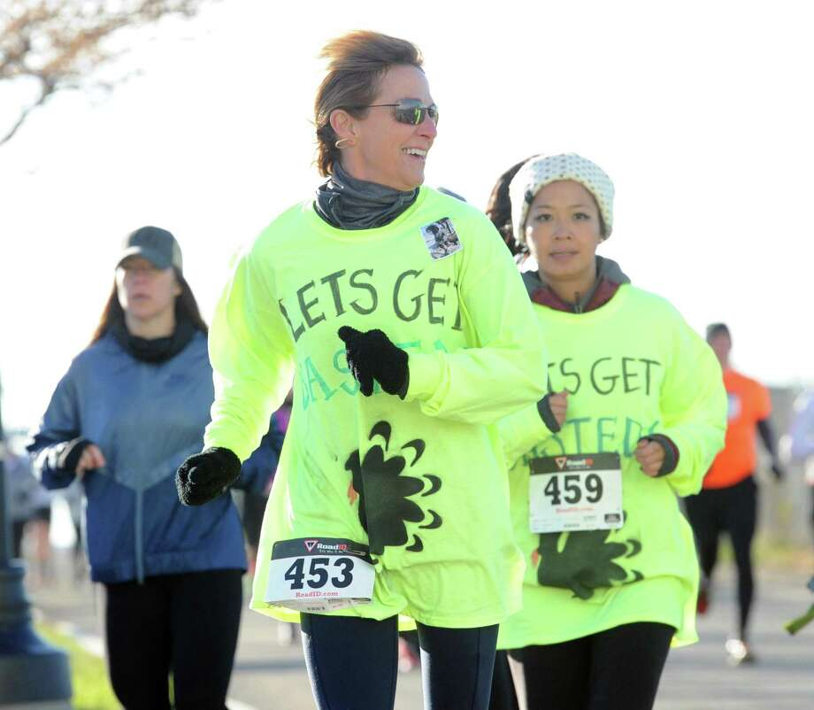 The 7th annual 5k Turkey Trot sponsored by the City of Stamford, Harbor Point and Exhale Studio at Harbor Point in Stamford, Conn., Thursday, Nov. 23, 2017. Yancey Lawrence of Stamford finished first in the race beating Sean McCarthy who finished second. Photo: Bob Luckey Jr. / Hearst Connecticut Media / Greenwich Time