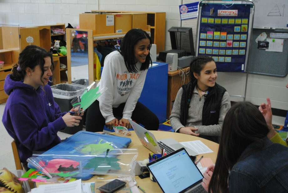 Danbury High School students discuss their lesson plans for the Little Hatters preschool program, which gives students the chance to teach a real-life preschool class this month. Photo: Contributed Photo / Danbury Public Schools