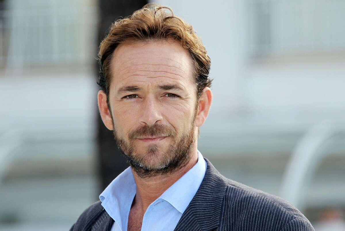 """(FILES) In this file photo taken on October 05, 2010 Actor Luke Perry poses during the TV series photocall """"Goodnight for Justice"""" during the 26th edition of the five-day MIPCOM, on October 5, 2010 in Cannes. - Actor Luke Perry, who starred in the hit 1990s television series """"Beverly Hills, 90210,"""" died on March 4, 2019 at the age of 52 after suffering a massive stroke, his agent said."""