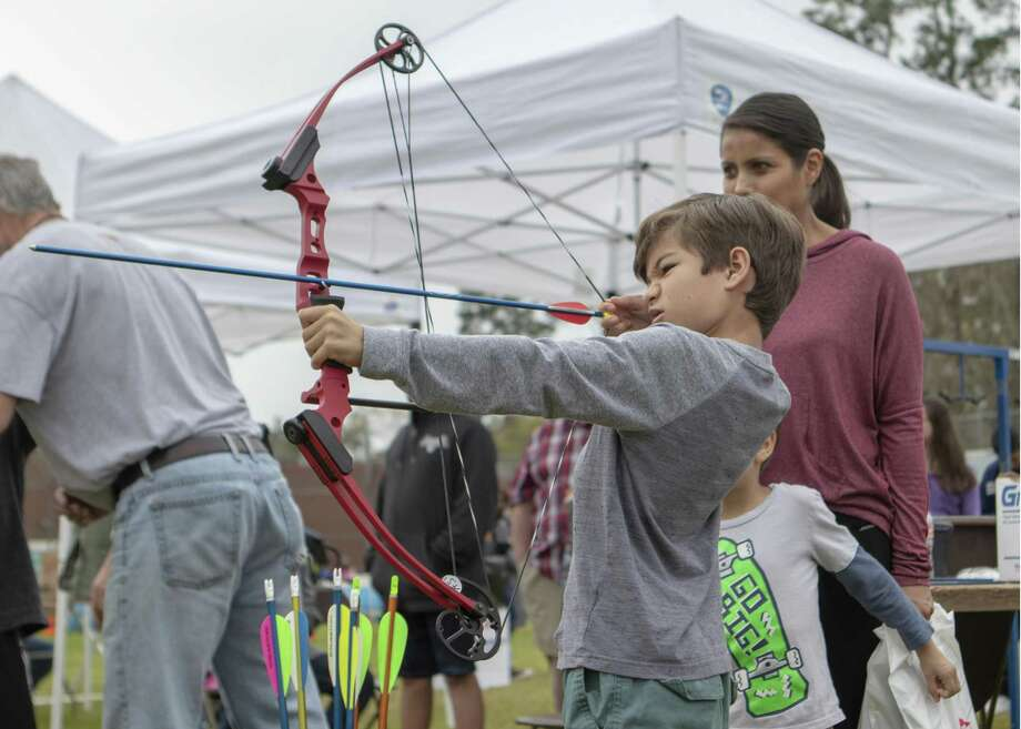 Quin Okeeffe, 7, pulls back on the strings of a bow at an archery range during the 15th Annual Texas Wildlife & Woodland Expo Spring Fling 2019 on Saturday, at Lone Star College-Montgomery in Conroe and Montgomery. Photo: Cody Bahn, Houston Chronicle / Staff Photographer / © 2018 Houston Chronicle