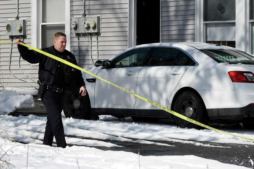 A Cohoes police officer is posted at the scene of a weekend homicide at 268 Remsen Street on Monday, March 4, 2019, in Cohoes, N.Y. Police have charged Andrew Lathrop, 23, in the death of Sara Pascale, 31. Pascale was found stabbed to death when police arrived at the scene on Sunday morning. (Will Waldron/Times Union)