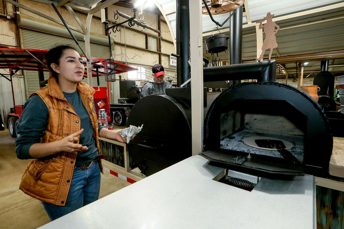 """Taiz Ochoa, 17, talks about the pizza oven she included in the trailer barbecue pit she named """"Living & Grilling"""" she built for the Junior Agricultural Mechanics Show at the San Antonio Stock Show and Rodeo. The trailer is the fourth one Ochoa, a senior at Roma High School, has built."""