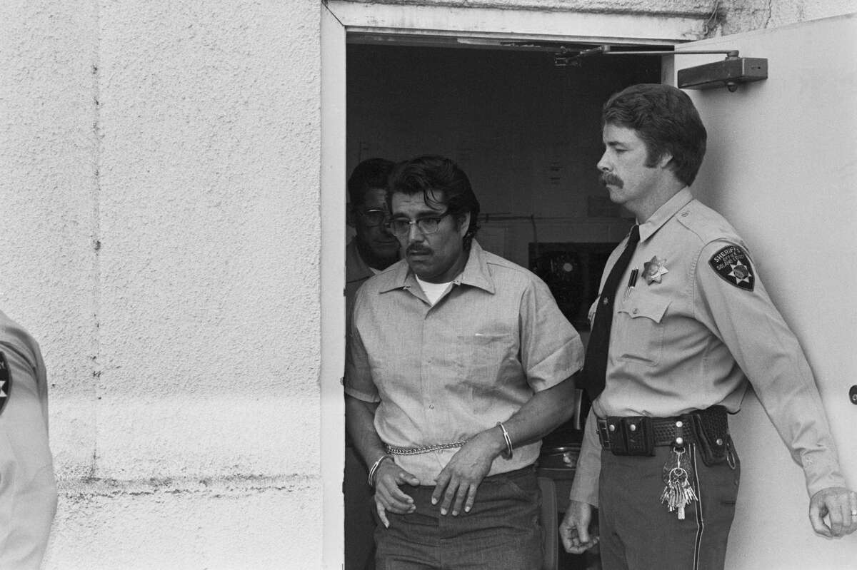 Farm labor contractor Juan Corona, accused of murdering 25 migrant workers, leaves the courthouse during a court recess during his trial in the 1970s.
