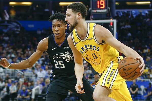 c1ac320673dd 1of3Golden State Warriors guard Klay Thompson (11) drives around Orlando  Magic forward Wesley Iwundu (25) during the second quarter of an NBA  basketball ...