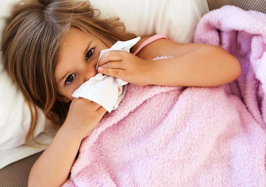 Available data suggests children infected with COVID-19 may be at a lower risk for complications and death. Photo: Tribune News Service