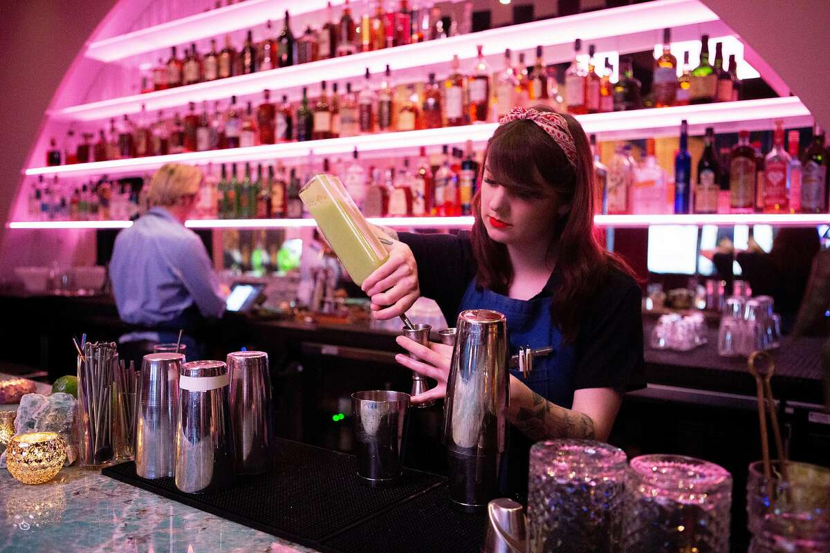 Bartender Alex Kulick makes drinks for customers at the Moongate Lounge on Saturday, March 2, 2019, in San Francisco, Calif. The lounge is located above above Mister Jiu's restaurant at 28 Waverly Pl.