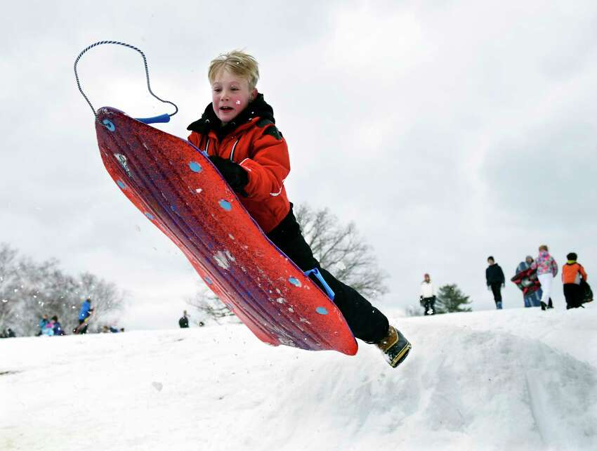 Greenwich's Harry Raabe, 9, catches air on a sled jump at Innis Arden Golf Club in Old Greenwich, Conn. Monday, March 4, 2019. Greenwich received eight inches of snow that caused school to be cancelled for the first time in the 2018-2019 year.