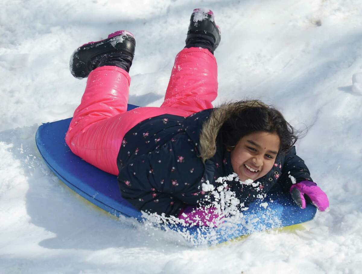 Riverside's Abhi Neelavalli, 7, sleds at the International School at Dundee in the Riverside section of Greenwich, Conn. Monday, March 4, 2019. Greenwich received eight inches of snow that caused school to be cancelled for the first time in the 2018-2019 year.