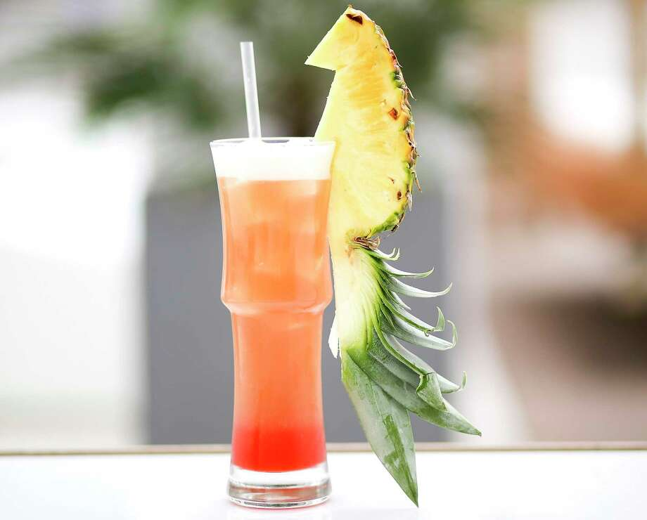Cayman Account, a cocktail at 77 Degrees, a stylish new patio lounge on four levels in Midtown. Photo: Elizabeth Conley, Staff Photographer / © 2018 Houston Chronicle