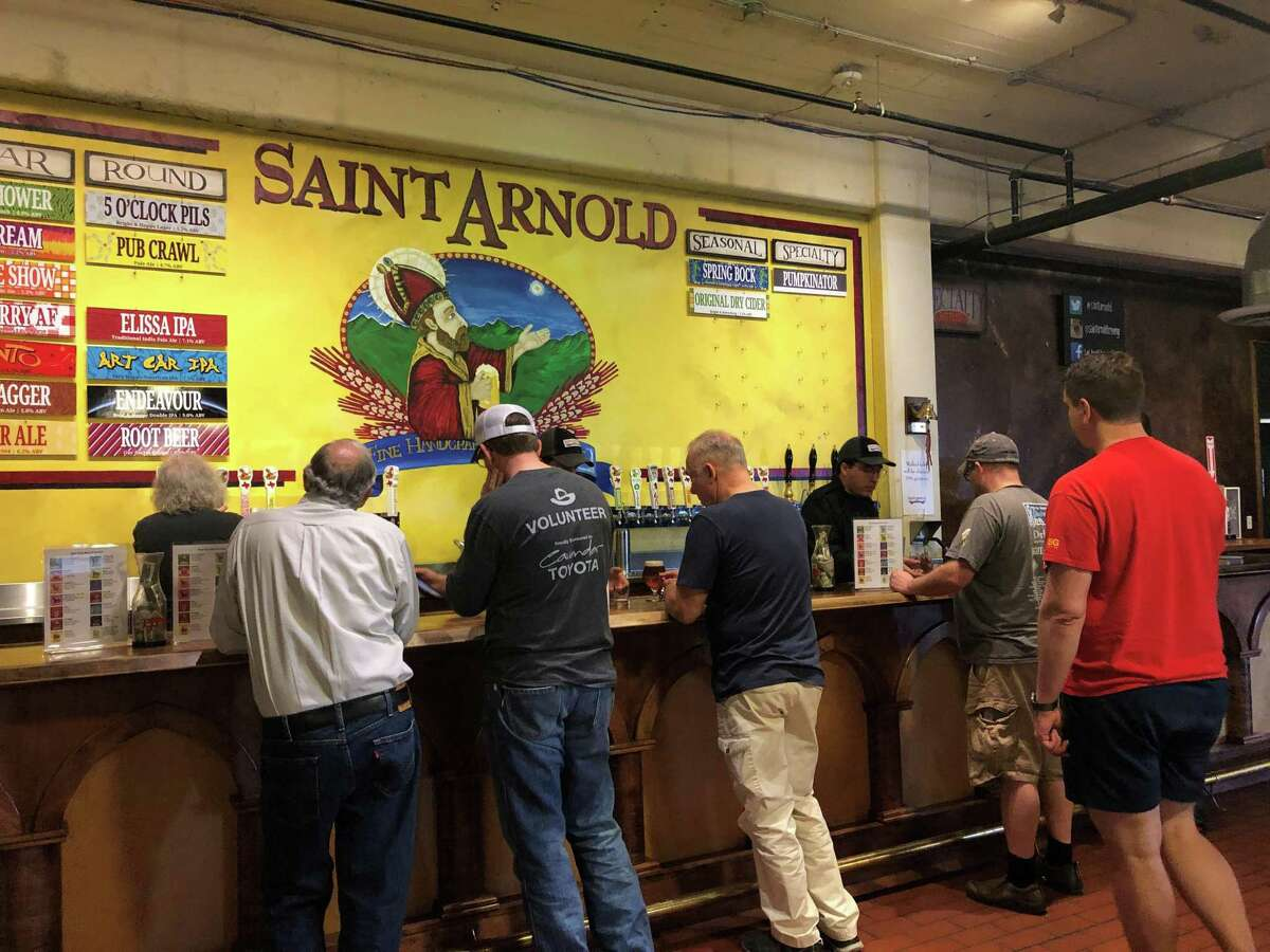 At the 15th annual Houston rally hosted by the American Homebrewers Association at Saint Arnold Brewing Company on Saturday, Feb. 23, beer lovers line up to partake of the brewery's offerings.
