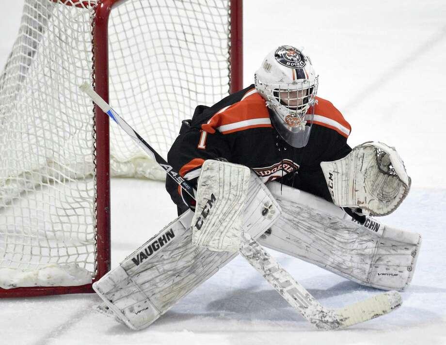 Ridgefield goalie Sean Gordon defends the net against Darien during an FCIAC Boys Ice Hockey game at Terry Conners Rink on Friday, Feb. 16, 2018 in Stamford, Connecticut. Ridgefield defeated Darien 5-3. Photo: Matthew Brown / Hearst Connecticut Media / Stamford Advocate