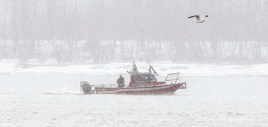 Alton firefighters started their search in blizzard-like conditions on the Mississippi River midday Sunday for a man, identified Monday by Alton police as a 72-year-old Godfrey man, who was reported as having jumped into the river from the Clark Bridge. A body had not been recovered as of Monday afternoon. Photo: John Badman | The Telegraph