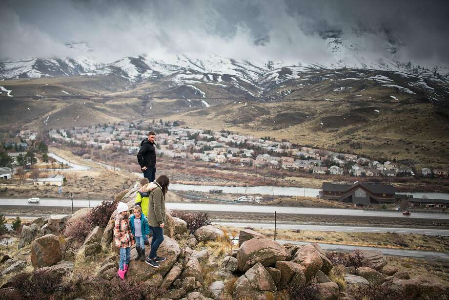 Bryan Allegretto walks with his family to the top of a hill that he owns in Reno, Nevada. Photo: AJ Marino / Special To The Chronicle