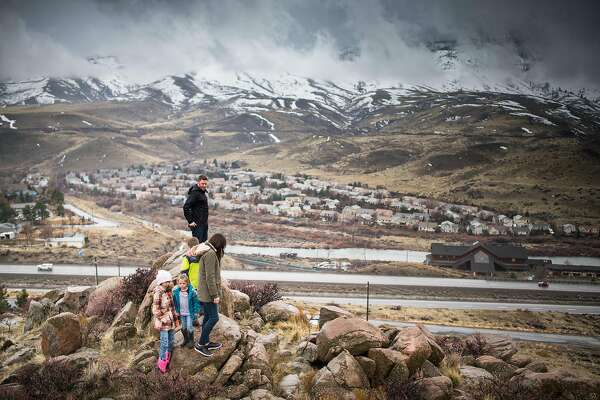 Bryan Allegretto walks with his family to the top of a hill that he owns in Reno, Nevada on Sunday March 3rd, 2019