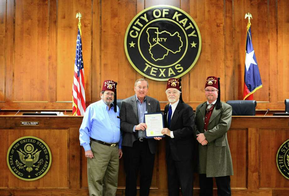 Katy Mayor Chuck Brawner proclaimed March 12 as IHOP National Pancake Day at the Feb. 25 Katy City Council meeting in connection with an upcoming fundraiser for the Shriners Hospital for Children. From left are Shriners Jeff Buchanan, Brawner, West Side Shrine Club President David Frishman and Shriners Jim Muller. Photo: West Side Shrine Club / West Side Shrine Club / ABOCO_Images