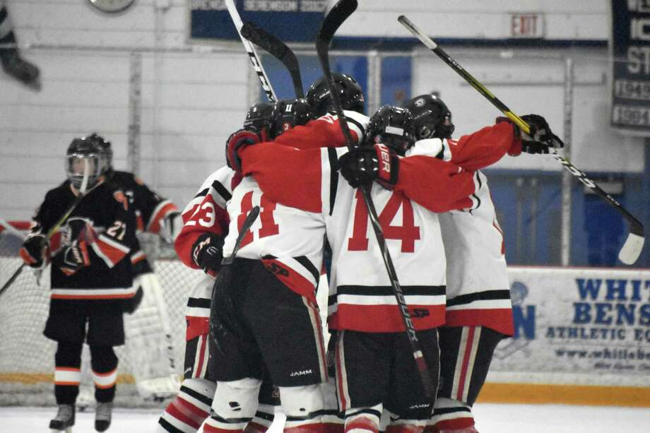 Branford celebrates Jack Manware's first period goal in the SCC/SWC Divison III championship game at Bennett Rink, West Haven. (Pete Paguaga, Hearst Connecticut Media)