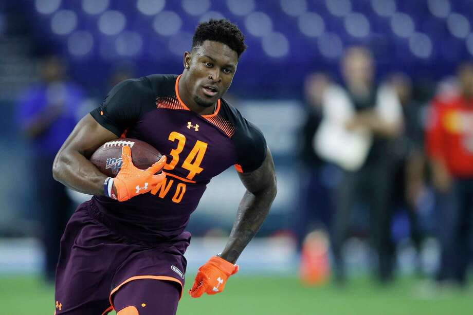 """What excites you the most about wide receiver D.K. Metcalf? Carroll: """"Well, it's almost like, what doesn't, you know? I mean, he's big and he's fast. He's got really good feet, you know, and his catching range was exhibited (Friday) for a start. And you know, we've got to figure it out, figure out where it is, maybe even more unique than we thought coming in. So we just develop it as we go. But big and really fast and the catching range was really obvious today."""" Photo: Joe Robbins, Getty Images / 2019 Getty Images"""