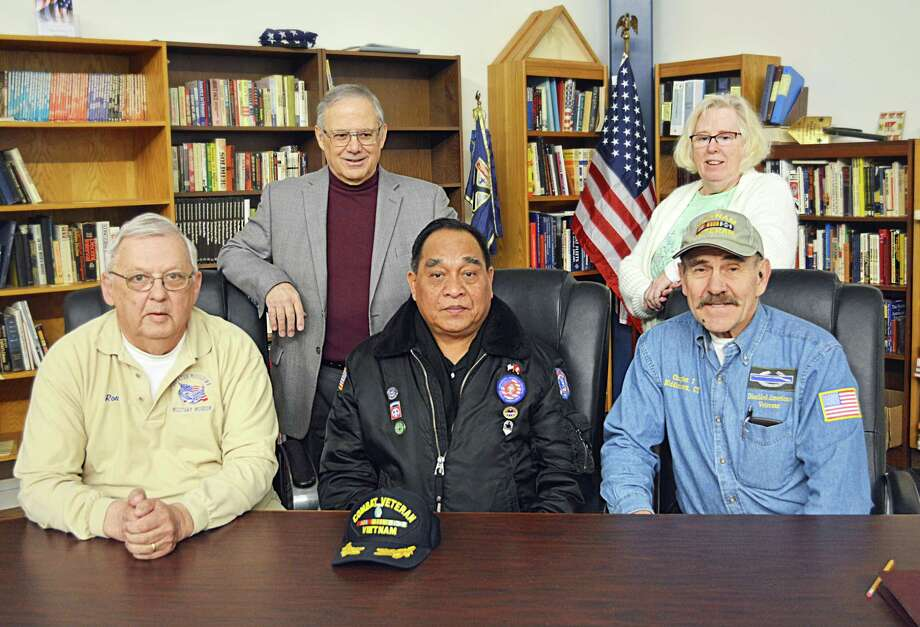 Greater Middletown Military Museum members, from left, Ron Organek (board president), Bill Corvo, Ret. Gen. Sar Phouthasack, Janet Maune (secretary) and Jerry Augustine are shown in the library Friday morning. The museum, at 200 Walnut Grove Road, situated next to the Connecticut Trees of Honor at Veterans Park, will host a grand opening and ribbon cutting for the facility April 13. Photo: Cassandra Day / Hearst Connecticut Media