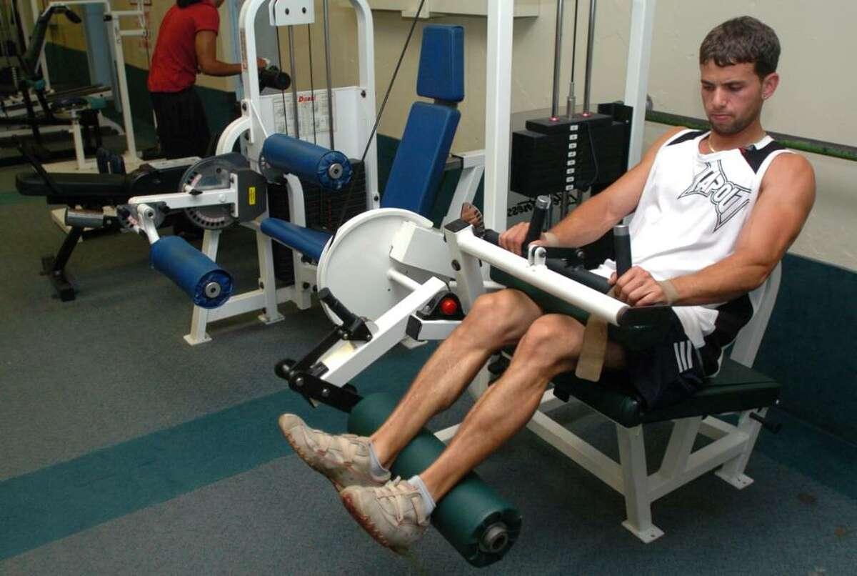 Alfredo Campos, 27, of Danbury, does leg exercises at the War Memorial in Danbury, July 23, 2010.