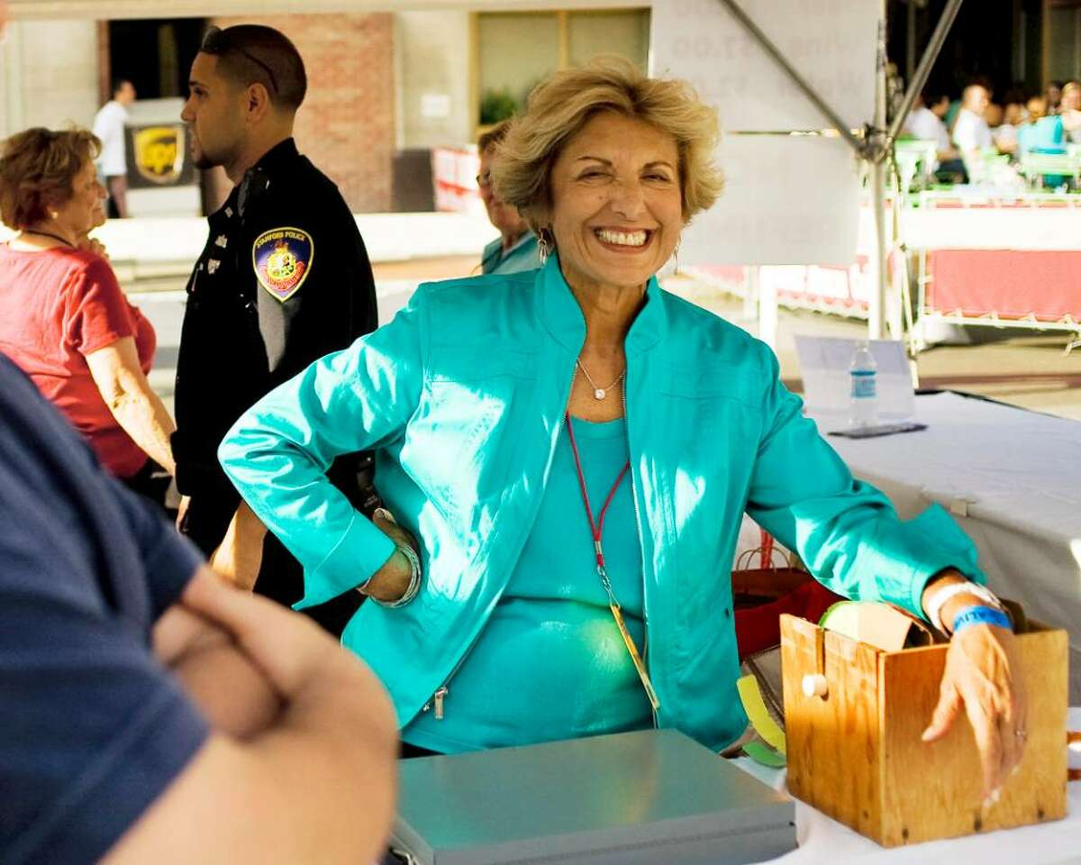 Sandy Goldstein, president of the Downtown Special Services District, works at a booth during the Thursday, July 22, 2010 Alive @ Five concert in Columbus Park in Stamford featuring Big Bad Voodoo Daddy.