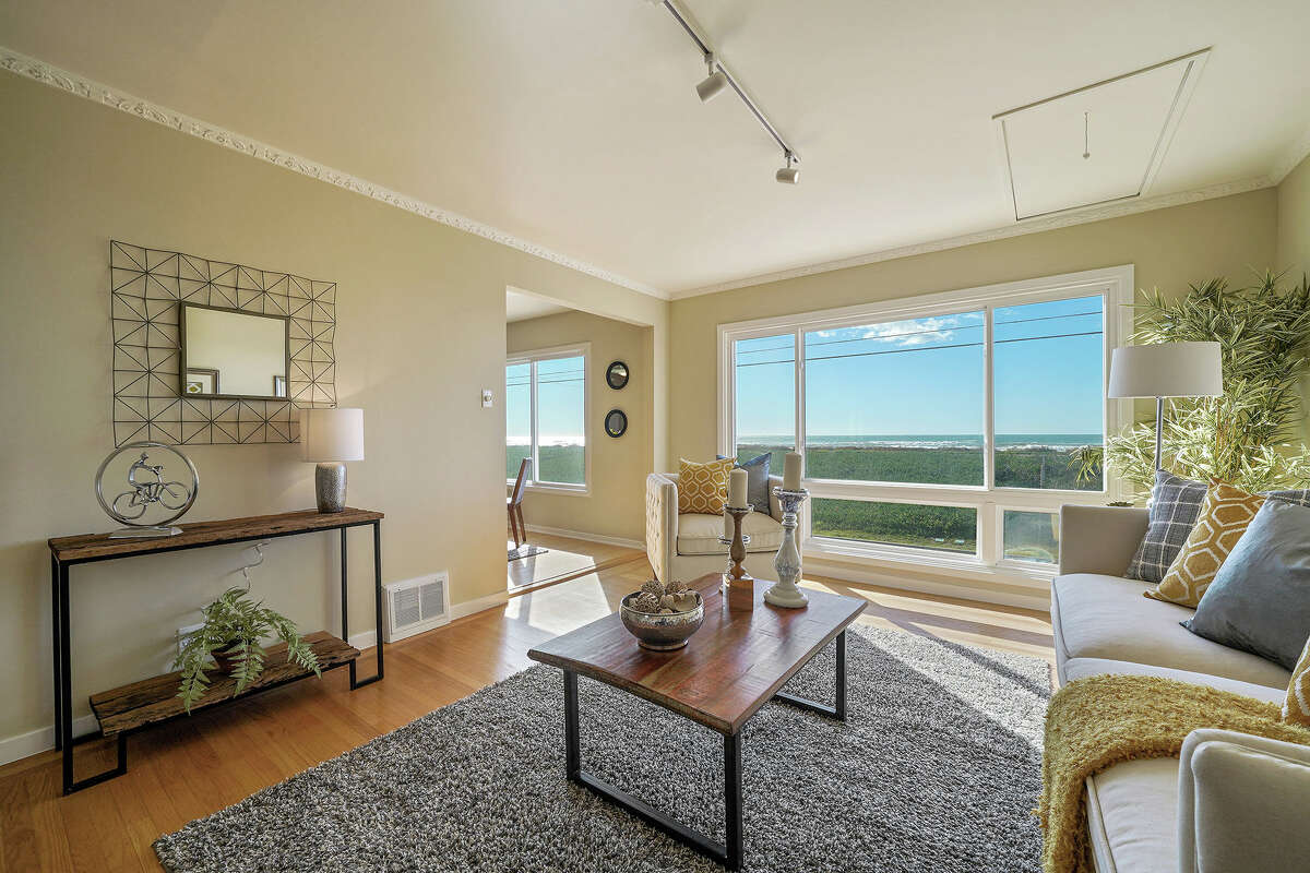 A two-bedroom, one bathroom home at 2140 Great Highway is listed for $1.495 million. You can see the ocean from the living room.