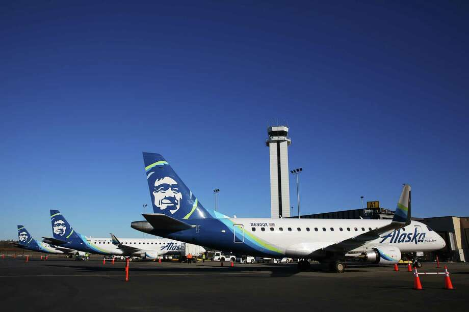 Alaska Airlines planes wait to transport the first passengers to their destinations as commercial flights began Monday morning at the new Everett Paine Field Airport terminal, March 4, 2019. The inaugural flight left at 10 am, carrying state and local dignitaries to Portland, and two subsequent flights departed to Las Vegas and Phoenix. The opening ceremony included a ribbon cutting and unveiling of a statue of Lt. Topliff Paine, the Everett army pilot for whom the airport is named. Alaska and United Airlines will have offer a combined 24 flights daily to nine destinations. Photo: Genna Martin / seattlepi.com