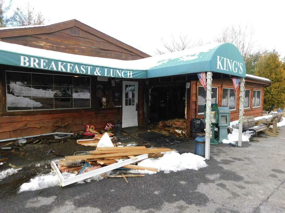 An SUV crashed into King's Breakfast & Lunch near the restaurant's entrance Monday afternoon. Photo: Kendra Baker / Hearst Connecticut Media