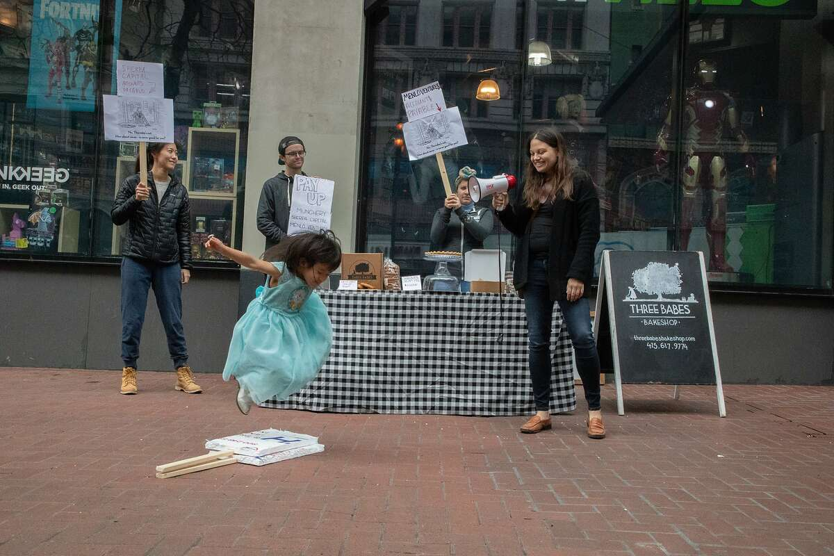 Lyra Selin, 3, jumps over a sign in front of Christine Kan, Gabe Taylor, and Lenore Estrada,cofounder, and CEO of SF's Three Babes Bakeshop, outside Sherpa Capital, which was one of its main VC funders on Tuesday, Jan. 29, 2019, in San Franciso, CA.