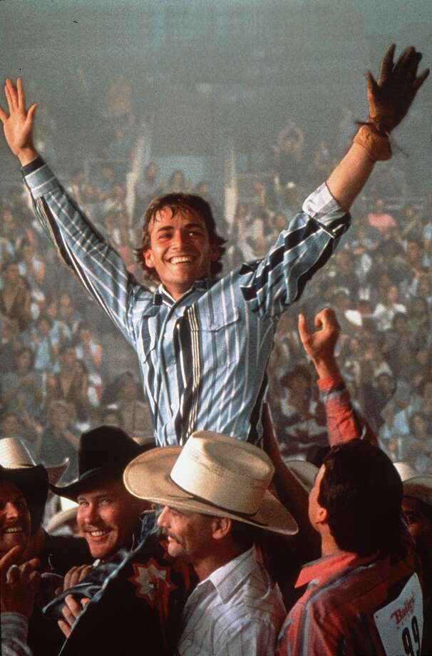 "CHRONICLE 02/25/94 // LUKE PERRY PLAYS YOUNG RODEO STAR LANE FROST IN ""8 SECONDS."" Photo: Chronicle"