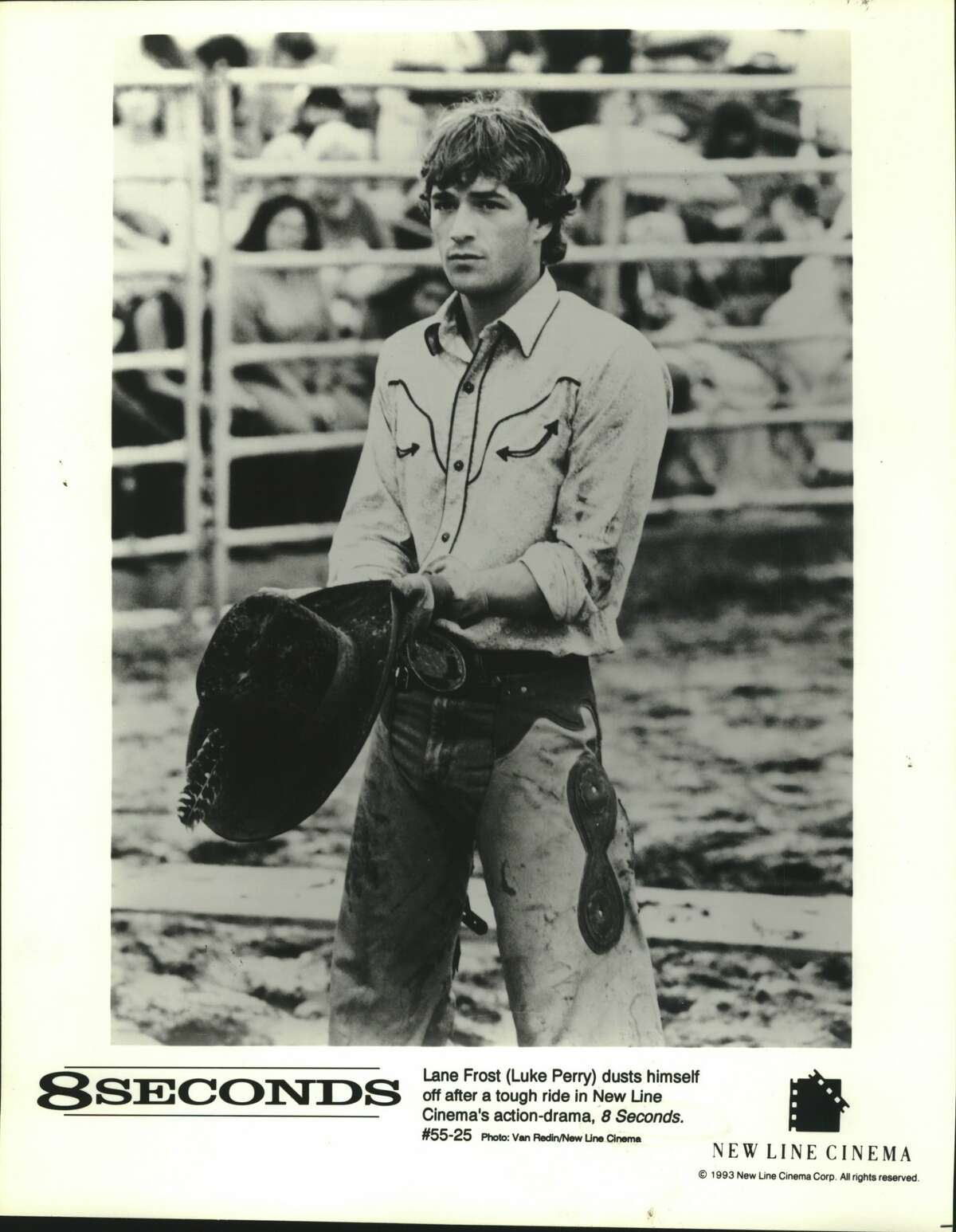 Lane Frost, Luke Perry, dusts himself off after a tough ride in New Line Cinema's action-drama, 8 Seconds.