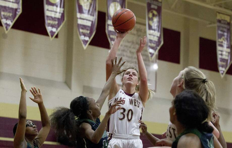 Magnolia West power forward Hannah Eggleston (30) shoots over Bryan Rudder defenders during the second quarter of a District 19-5A high school basketball game at Magnolia West High School, Tuesday, Jan. 15, 2019, in Magnolia. Photo: Jason Fochtman, Houston Chronicle / Staff Photographer / © 2019 Houston Chronicle