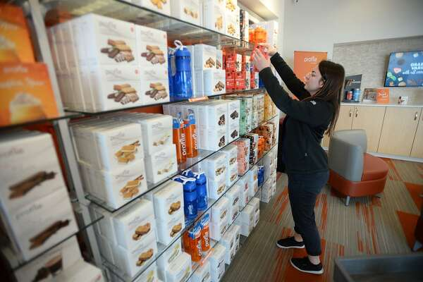 Chelsey Wigginton stocks food on the shelves at Profile By Sanford in Beaumont on Monday. The company offers meal plans and dietary specialists to help people lose weight. Photo taken Monday, Photo taken Monday, 3/4/19