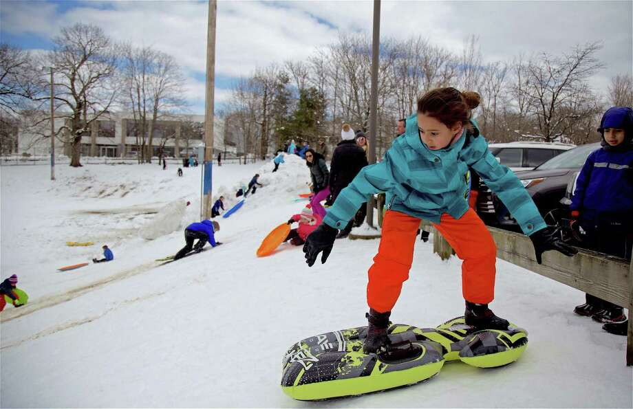 Manar Abis, 10, of Westport, gets ready to head down the hill while standing at Greens Farms School in March in Westport. Photo: Jarret Liotta / For Hearst Connecticut Media / Westport News Freelance