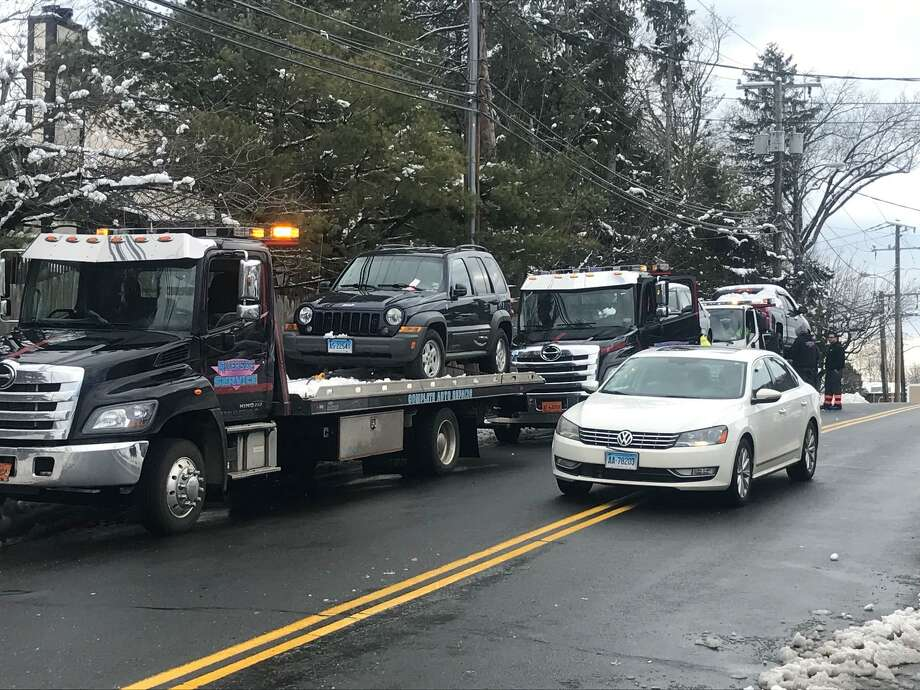 Tow trucks outside Riverside Towing on Research Drive bringing in vehicles illegally parked on Stamford streets. Photo: John Nickerson / Staff