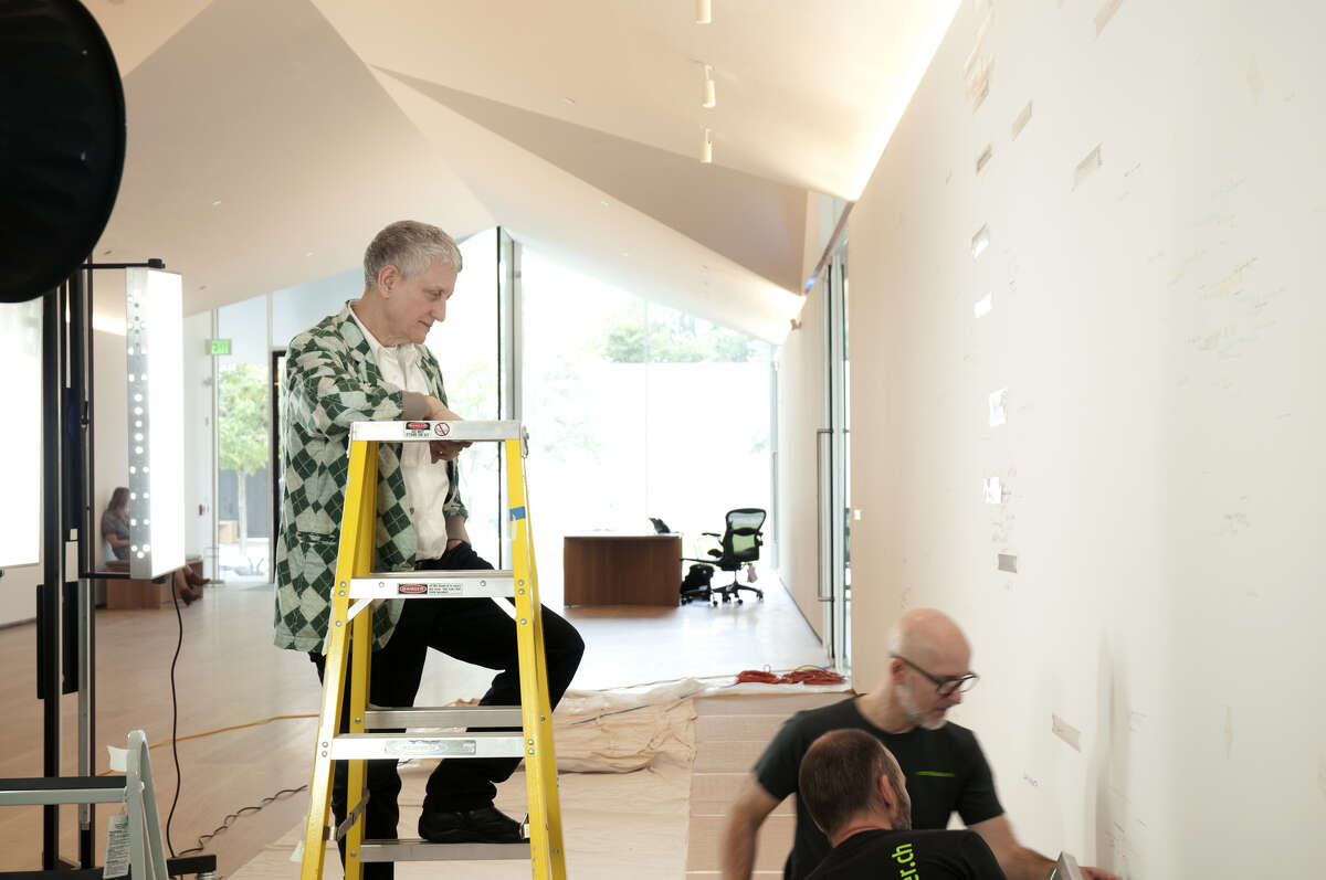 """Roni Horn supervising the installation of her """"Wits' End Sampler"""" at the Menil Drawing Institute."""