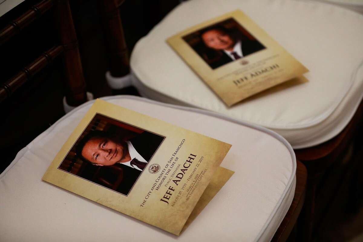 Programs sit on seats ahead of Public Defender Jeff Adachi's memorial service at City Hall in San Francisco, California, on Monday, March 4, 2019.