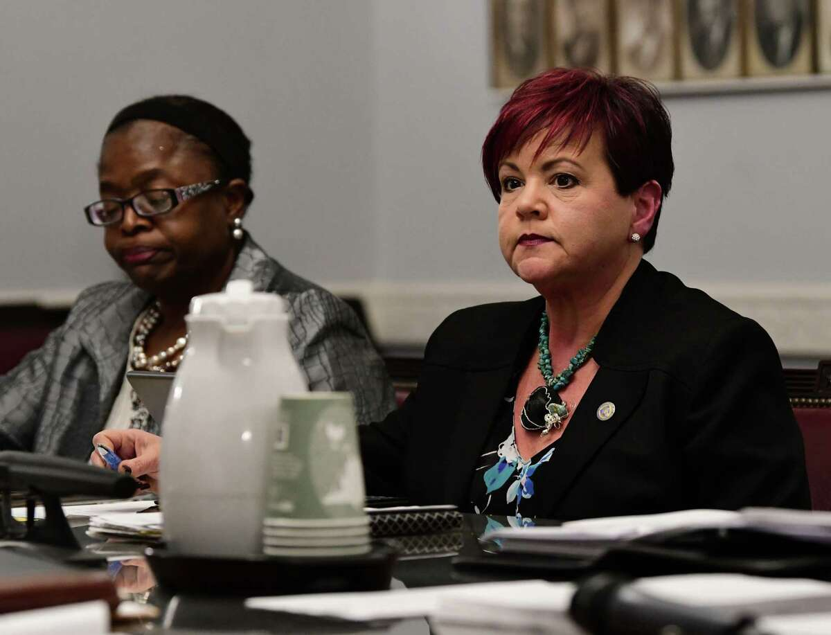 Schenectady City Council members Marion Porterfield, left, and Leesa Perazzo listen as the Schenectady City Council takes the first step in overriding Mayor Gary McCarthy's rejection of their plan to keep four city court judges in the city at City Hall on Monday, March 4, 2019 in Schenectady, N.Y. (Lori Van Buren/Times Union)