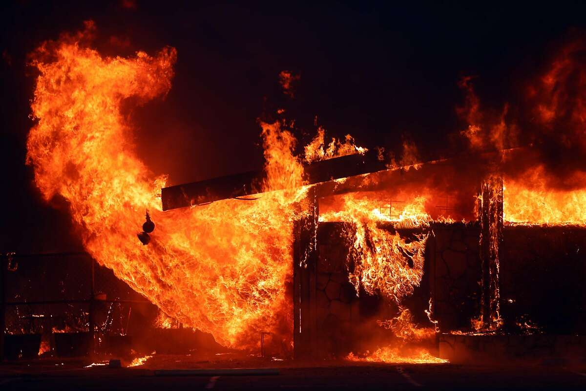 A business burns during Camp Fire in Paradise, Calif.. on Thursday, November 8, 2018.