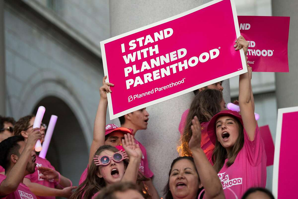 Supporters of Planned Parenthood gather to call on Congress not to ban people on Medicaid from receiving care at Planned Parenthood health centers. Los Angeles, California on June 21, 2017. Defunding Planned Parenthood will deny millions of low- income women access to cancer screenings, birth control and testing for sexually transmitted diseases. (Photo by: Ronen Tivony) (Photo by Ronen Tivony/NurPhoto via Getty Images)