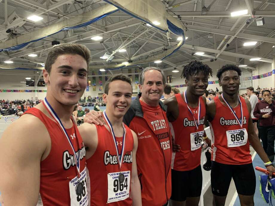From left to right, Greenwich High School's 4 x 200-meter relay team of Lance Large, Zane Nye, Ryan Raybuck and Chris Wint placed second at the New England Championships this past weekend in Boston. Pictured with the athletes is Greenwich coach Jeff Klein. Photo: Contributed Photo / Greenwich Time Contributed