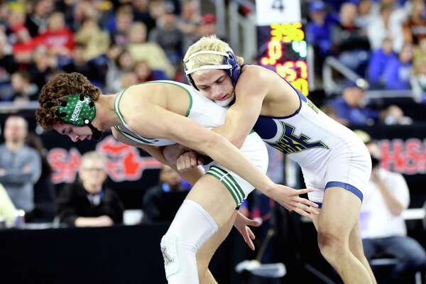 Bad Axe's Ryan Wehner tangles with Mendon's Skyler Crespo during the Division 4 state championship match at 140 pounds, Saturday, at Ford Field, in Detroit. (Luann Parks/For the Tribune)