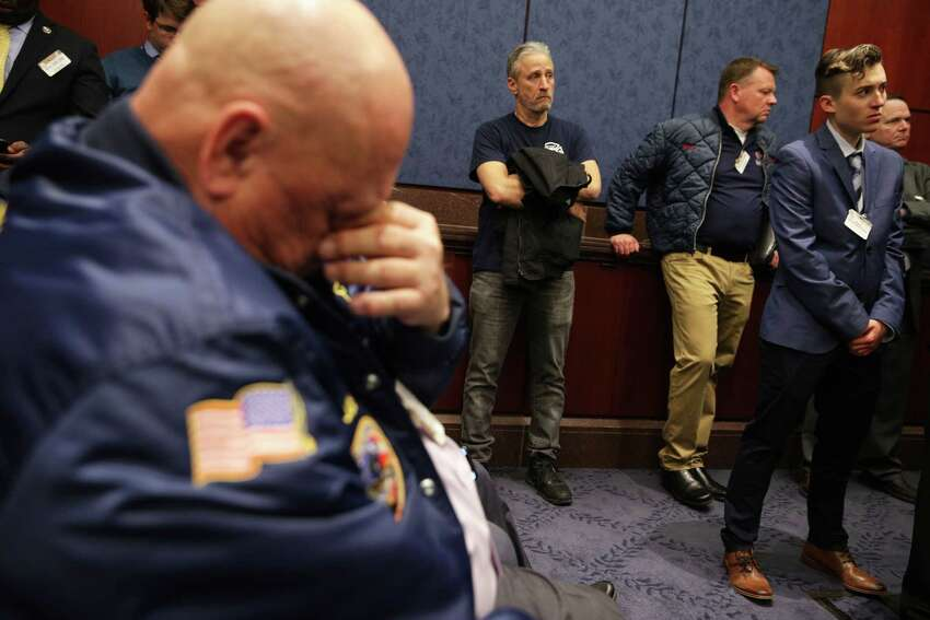 WASHINGTON, DC - FEBRUARY 25: Comedian and advocate for 9/11 first responders Jon Stewart (C) listens during a news conference February 25, 2019 on Capitol Hill in Washington, DC. Joined by 9/11 first responders, survivors and their families, Sen. Kirsten Gillibrand (D-NY) held a news conference to discuss the introduction of the bipartisan