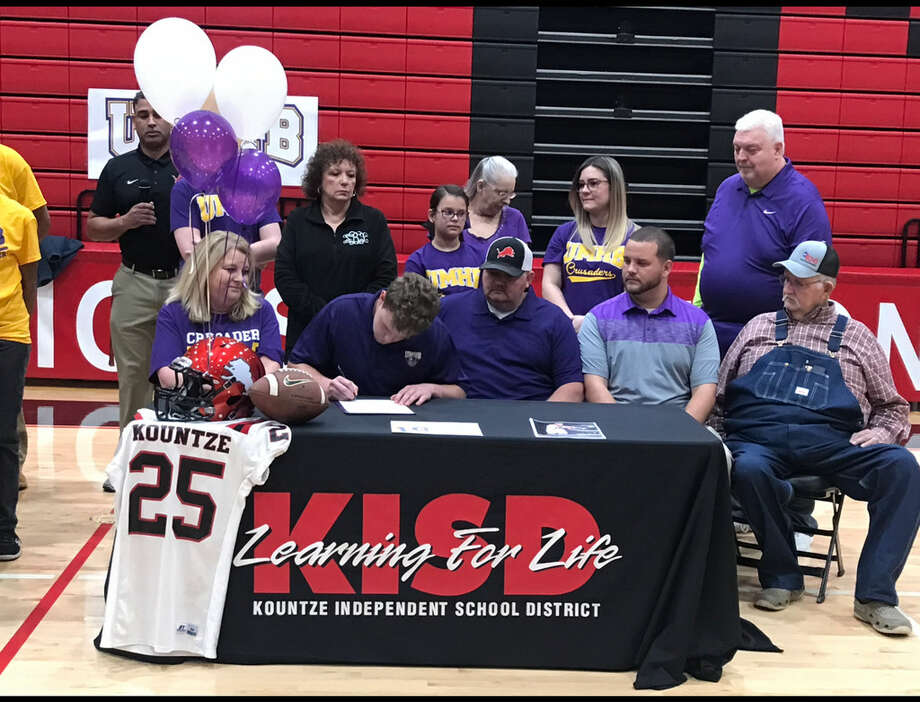 Kountze's Cayson Beal signs his national letter of intent to play football at Mary Hardin-Baylor. Photo: Meshach Sullivan  / The Enterprise