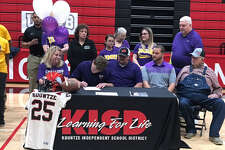 Kountze's Cayson Beal signs his national letter of intent to play football at Mary Hardin-Baylor.