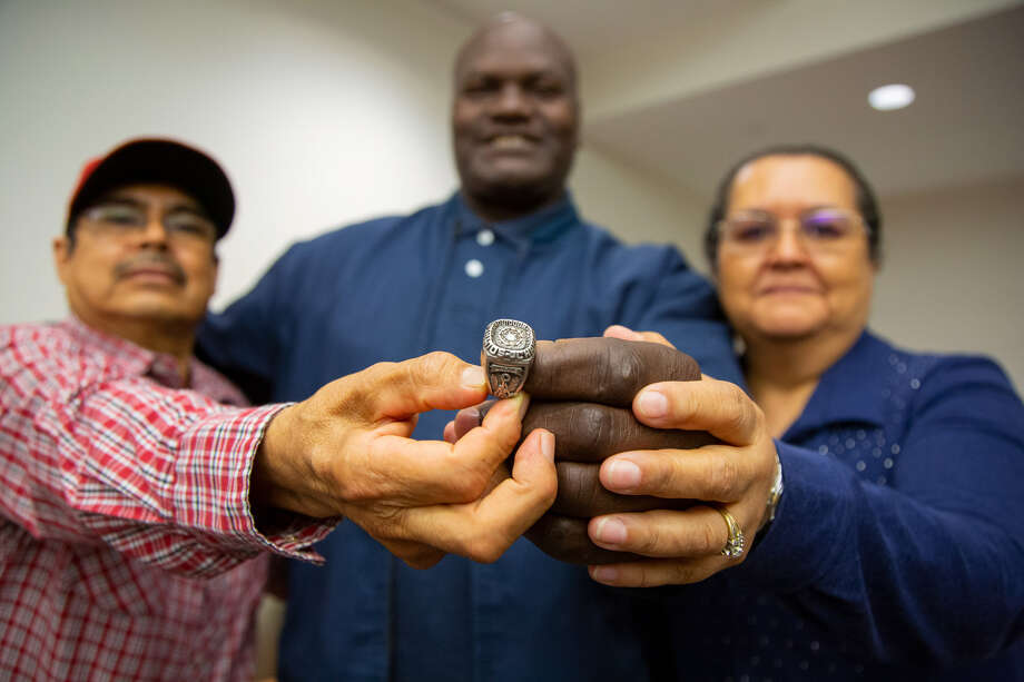 Francisco Gudino, Jackie Harris and Alicia Gudino (left to right) pose for a picture with Harris' ring on Monday during a ceremony on Lamar's campus. Photo provided by Lamar athletics. Photo: Lamar Athletics